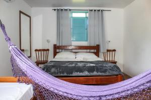 A bed or beds in a room at Enero Suites & Sports