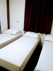 A bed or beds in a room at Residencial Saldanha