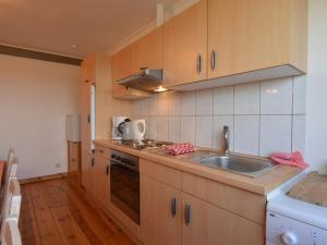A kitchen or kitchenette at Stylish Apartment in Heppenbach with Terrace