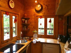A kitchen or kitchenette at Cozy Chalet in Bousseviller France with Private Sauna