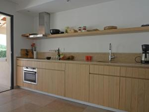 A kitchen or kitchenette at Villa Les Collines