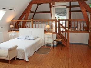 A bed or beds in a room at La Ferme de la Sensée