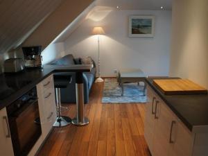 A kitchen or kitchenette at Intra Muros Vue Mer