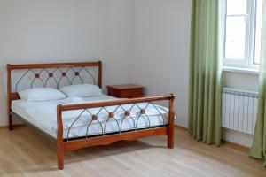 A bed or beds in a room at Sarai-Batu Guest House