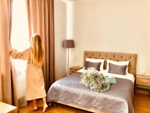A bed or beds in a room at Hotel DENINNA