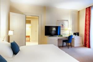 A bed or beds in a room at Welcome Hotel Residenzschloss Bamberg