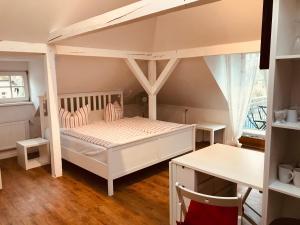 Ein Etagenbett oder Etagenbetten in einem Zimmer der Unterkunft Villa 1923