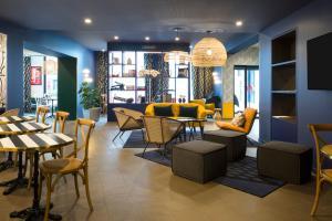 Restaurant ou autre lieu de restauration dans l'établissement Aparthotel Adagio Annecy Centre