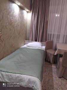 Кровать или кровати в номере Отель Выставка