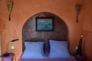 Un ou plusieurs lits dans un hébergement de l'établissement Dar Dayana