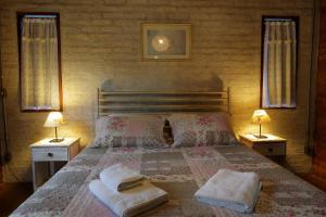 Cama ou camas em um quarto em Pousada Candeias