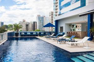 The swimming pool at or near Golden Tulip Porto Vitória