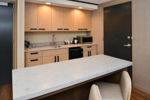 A kitchen or kitchenette at Hyatt Place Chicago/Wicker Park