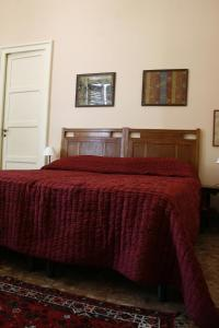 A bed or beds in a room at B&B Casa Demarata