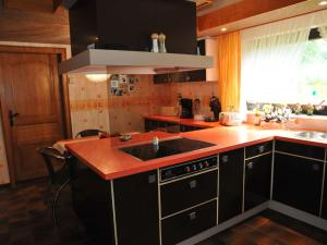 A kitchen or kitchenette at Quaint Villa in Amel with Sauna