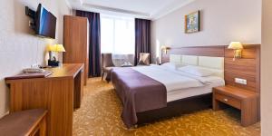 Кровать или кровати в номере Greenwich Hotel