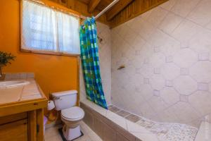 A bathroom at Mediterranean Style Home