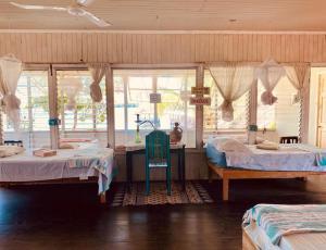 Cama o camas de una habitación en Hotel La Casa Rosada