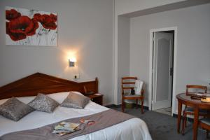 A bed or beds in a room at Marie Anne