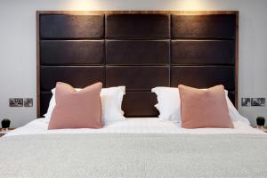 A bed or beds in a room at Mytton Fold Hotel, Ribble Valley