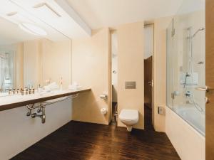 Vonios kambarys apgyvendinimo įstaigoje Residence Hotel