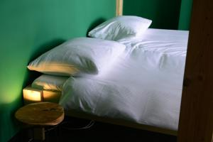 A bed or beds in a room at Hostel Roots