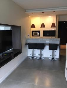 A television and/or entertainment centre at Loft Barra