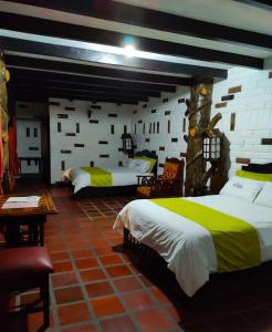 Cama o camas de una habitación en Jardines De Chamana
