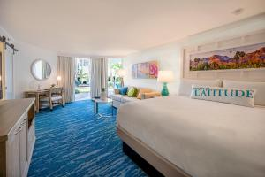A bed or beds in a room at Margaritaville Resort Palm Springs