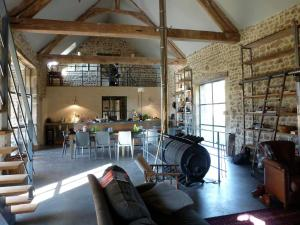 The lounge or bar area at Luxury Farmhouse with Private Garden near Forest in Braize