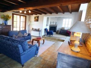 A seating area at Spacious Cottage with private pool in Villiers-Couture