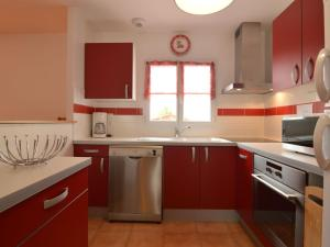 A kitchen or kitchenette at Modern Holiday Home in Avrille with Garden