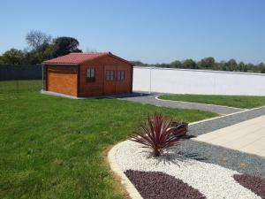 A garden outside Modern Holiday Home in Avrille with Garden