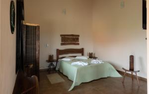 Cama ou camas em um quarto em Pousada Além das Formas