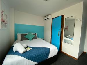 A bed or beds in a room at Base Backpackers - St Kilda