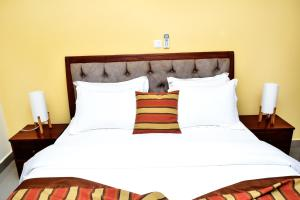 A bed or beds in a room at Loumia Premium Residency
