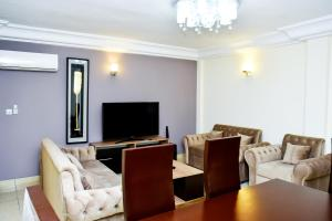 A television and/or entertainment center at Loumia Residency