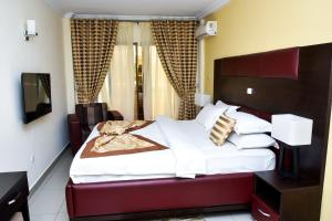 A bed or beds in a room at Loumia Residency
