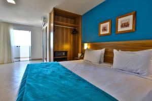 Cama ou camas em um quarto em ARCUS HOTEL Aracaju - antes COMFORT