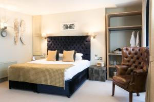 A bed or beds in a room at The Angel & Blue Pig