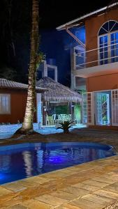 The swimming pool at or near Pousada Nova Ascalom