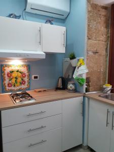 A kitchen or kitchenette at Casa Alessio