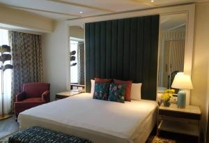 A bed or beds in a room at Blue Diamond Pune IHCL SeleQtions