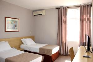 A bed or beds in a room at Hotel Foz do Iguaçu
