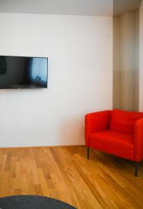 TV a/nebo společenská místnost v ubytování Backpacker Apartment Naschmarkt