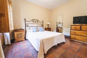 Cama o camas de una habitación en Hotel Humaina