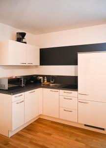Kuchyň nebo kuchyňský kout v ubytování Elegant Apartment Naschmarkt