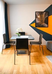 TV a/nebo společenská místnost v ubytování Elegant Apartment Naschmarkt
