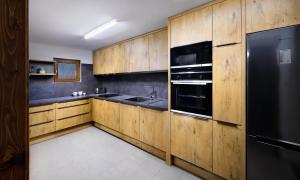 Kuchyňa alebo kuchynka v ubytovaní High Tatras Chalet