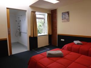 A bed or beds in a room at Hikurangi StayPlace